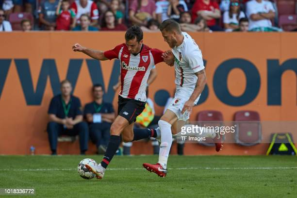 Inigo Lekue of Athletic Bilbao and Jeffrey Gouweleeuw of FC Augsburg battle for the ball during the friendly match between FC Augsburg and Athletic...