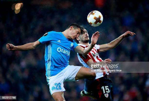 Inigo Lekue of Athletic Bilbao duels for the ball with Florian Thauvin of Marseille during UEFA Europa League Round of 16 match between Athletic Club...