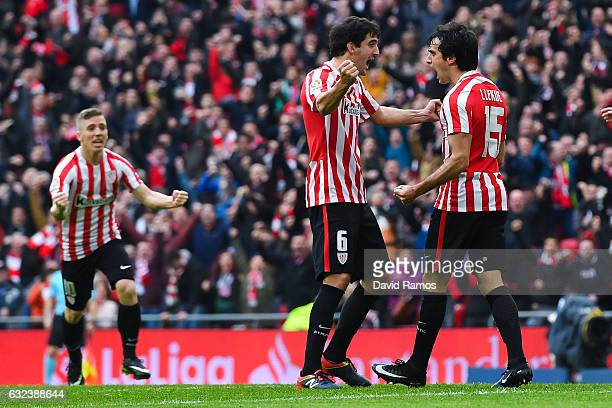 Inigo Lekue of Athletic Club celebrates with his team mate Mikel San Jose after scoring his team's first goal during the La Liga match between...