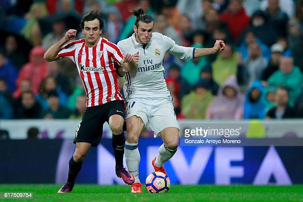 Inigo Lekue of Athletic Club tackles Gareth Bale of Real Madrid CF during the La Liga match between Real Madrid CF and Athletic Club de Bilbao at...