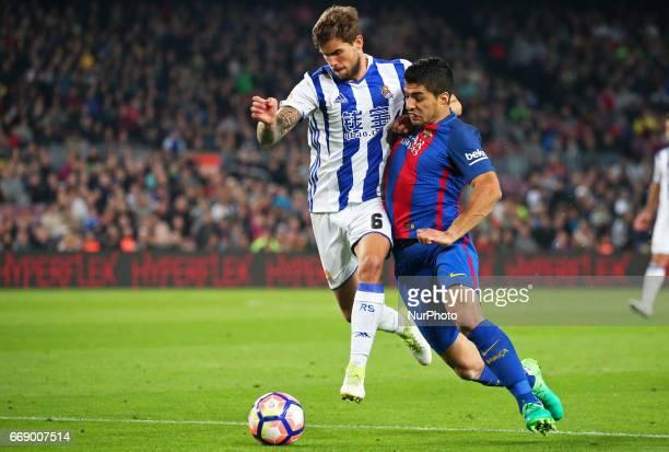 Inigo Martinez and Luis Suarez during La Liga match between FC Barcelona v Alaves during the La Liga match between FC Barcelona and Real Sociedad de...