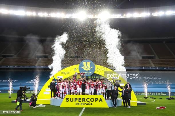Inigo Martinez of Athletic Bilbao celebrates victory with the Supercopa de Espana trophy after the Supercopa de Espana Final match between FC...