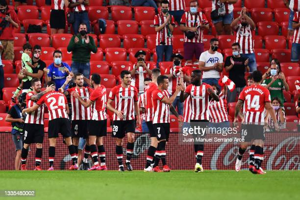 Inigo Martinez of Athletic Bilbao celebrates with his team after scoring the opening goal during the LaLiga Santander match between Athletic Club and...