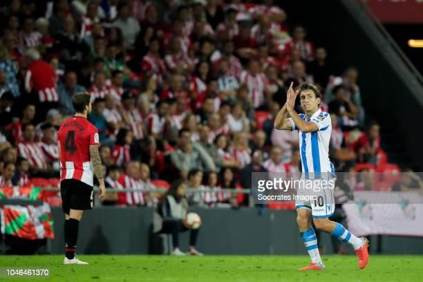 Inigo Martinez of Athletic Bilbao Mikel Oyarzabal of Real Sociedad during the La Liga Santander match between Athletic de Bilbao v Real Sociedad at...