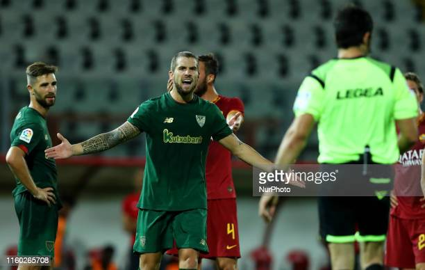 Inigo Martinez of Athletic Bilbao reclaims with the referee Fabio Maresca for the penalty awarded to Roma during the friendly match AS Roma v...
