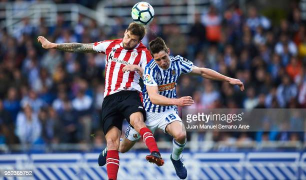 Inigo Martinez of Athletic Club competes for the ball with Aritz Elustondo of Real Sociedad during the La Liga match between Real Sociedad and...