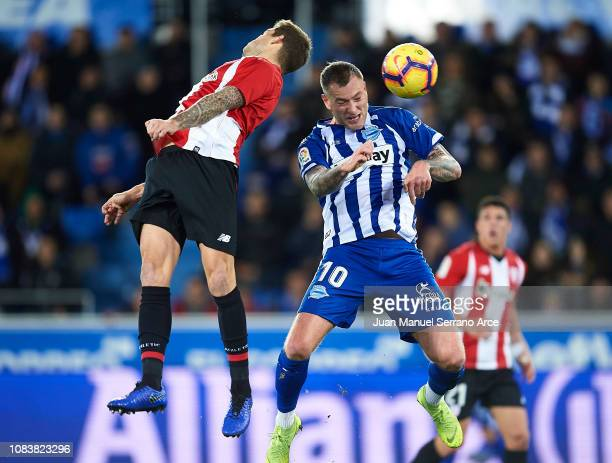 Inigo Martinez of Athletic Club duels for the ball with John Guidetti of Deportivo Alaves during the La Liga match between Deportivo Alaves and...