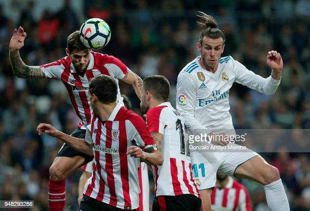 Inigo Martinez of Athletic Club wins the header before Gareth Bale of Real Madrid CFduring the La Liga match between Real Madrid CF and Athletic Club...