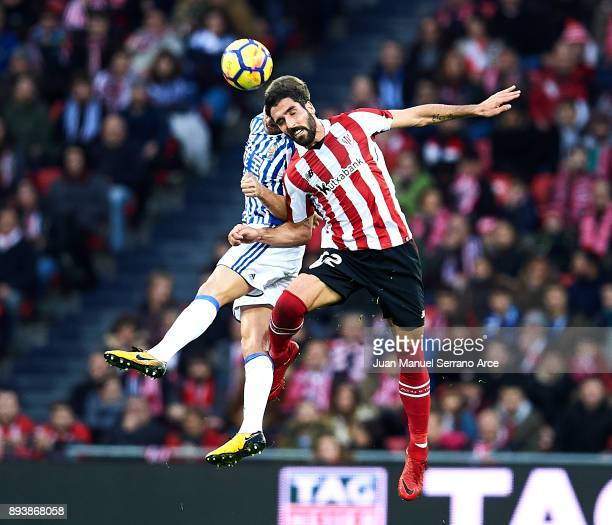 Inigo Martinez of Real Sociedad competes for the ball with Raul Garcia of Athletic Club during the La Liga match between Athletic Club Bilbao and...