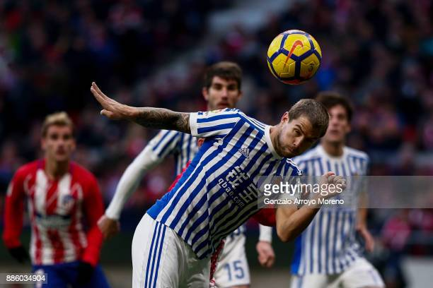 Inigo Martinez of Real Sociedad de Futbol saves on a header during the La Liga match between Club Atletico Madrid and Real Sociedad de Futbol at...