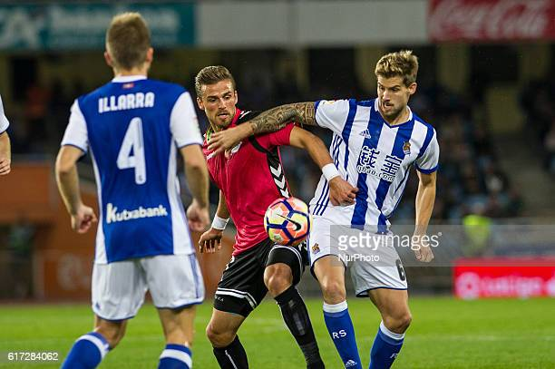 Inigo Martinez of Real Sociedad duels for the ball with Aleksandar Katai of Alaves during the Spanish league football match between Real Sociedad and...