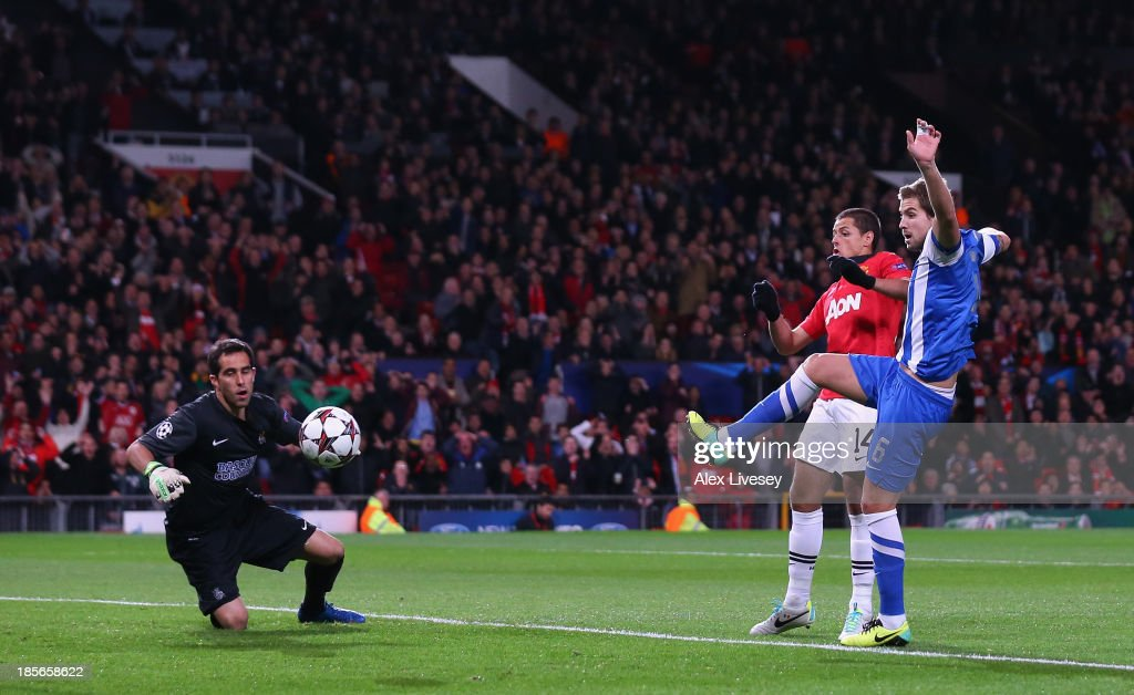 Inigo Martinez of Real Sociedad scores an own goal to make the score 1-0 during the UEFA Champions League Group A match between Manchester United and Real Sociedad at Old Trafford on October 23, 2013 in Manchester, England.