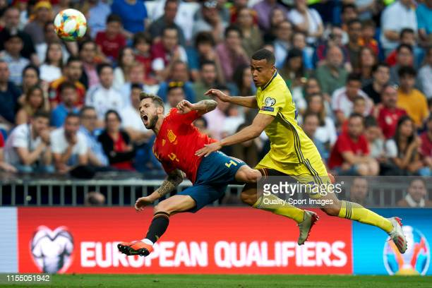Inigo Martinez of Spain battle for the ball with Robin Quasaison of Sweden during the UEFA Euro 2020 qualifier match between Spain and Sweden at...