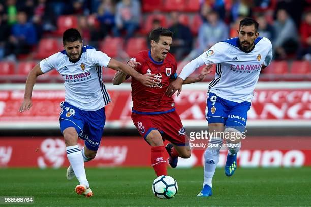 Inigo Perez of CD Numancia competes for the ball with Borja Iglesias and Papunashvili of Real Zaragoza during the La Liga 123 play off match between...