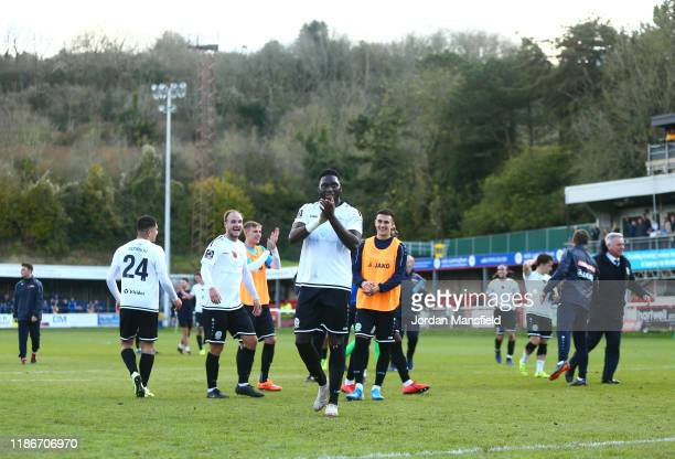Inih Effiong of Dover Athletic and team mates celebrate victory after the FA Cup First Round match between Dover Athletic and Southend United at...