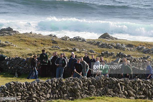 Inis Meain island in Inis Meain Ireland With the atlantic surf behind them and the spring sunshine above them Inishmaan islanders celebrate St...