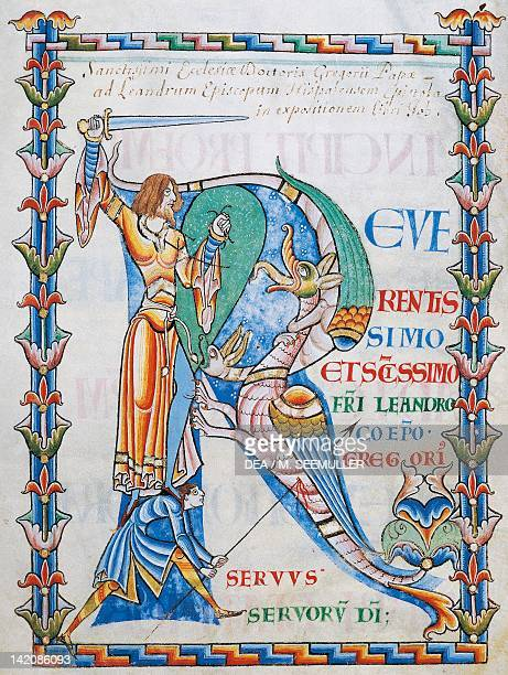 Initial capital letter R depicting two men fighting a dragon with a sword and a lance miniature from the Morals on the Book of Job by Saint Gregory...