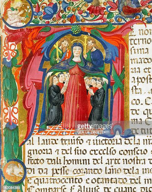 Initial capital letter with the Madonna miniature by Venetian Mariegola from art of wool manuscript Italy 14th Century