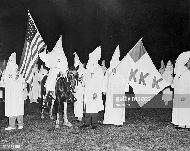 Initiation for new KKK members Jacksonville Florida Hooded members of the Duval chapter of the Florida Klu Klux Klan hold initiation ceremonies in...