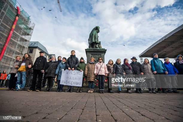 Initiator Gregory Richters gather together with people on Market Square to commemorate the victims of the recent shooting on February 21, 2020 in...