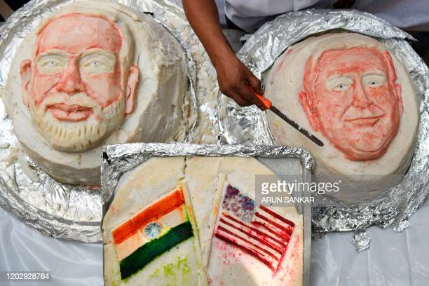Iniyan gives final touches to a idili savoury rice cake decorated in the shapes of US President Donald Trump and Indian Prime Minister Narendra Modi...