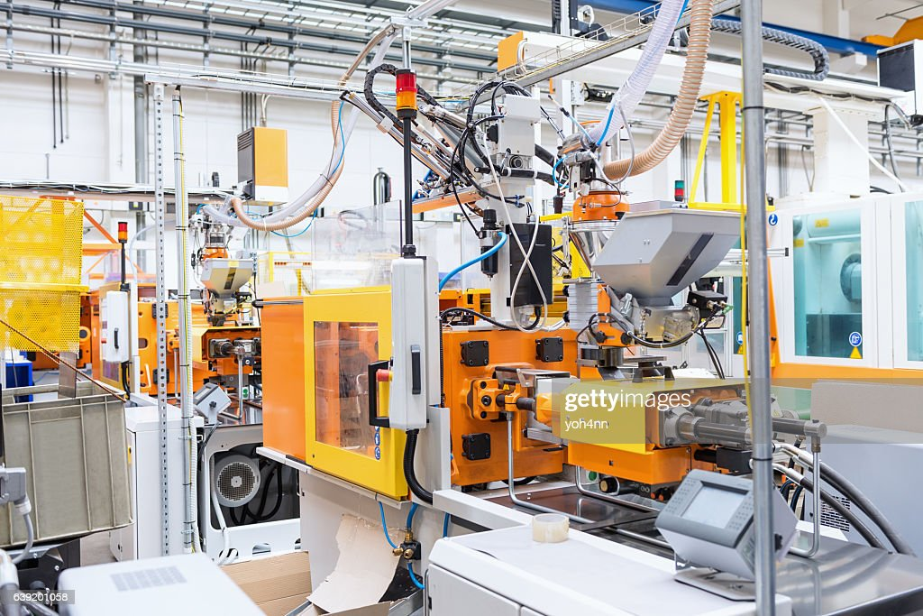 Injection moulding machine in plastic factory : Stock Photo