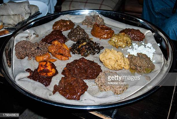 CONTENT] Injera is a yeastrisen flatbread with a unique slightly spongy texture Traditionally made out of teff flour it is a national dish in...