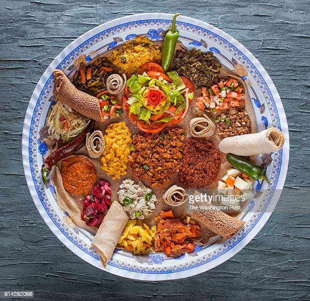 Injera Lined Vegetarian Platter The platter included three different types of injera Asa Dullet along with Misir Ater kik Gomen Tickeled Gomen...