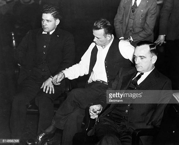 INJohn Dillinger notorius criminal in Indiana court manacled to Sheriff Holley At right is attorney Joseph Ryan Photograph