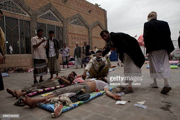 Injured anti-government protesters receive first aid in Sanaa. .Yemen's president has declared a nationwide state of emergency after snipers killed...