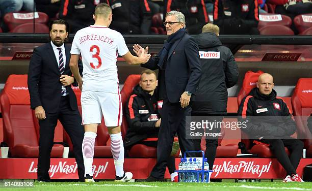 Injured Artur Jedrzejczyk of Poland and Adam Nawalka coach of Poland during the Group E First Round World Cup Qualifier between Poland and Armenia at...
