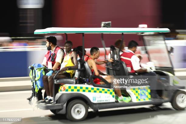 Injured athletes are carrying on a medical car back to the finish during in the Men's Marathon on day nine of 17th IAAF World Athletics Championships...