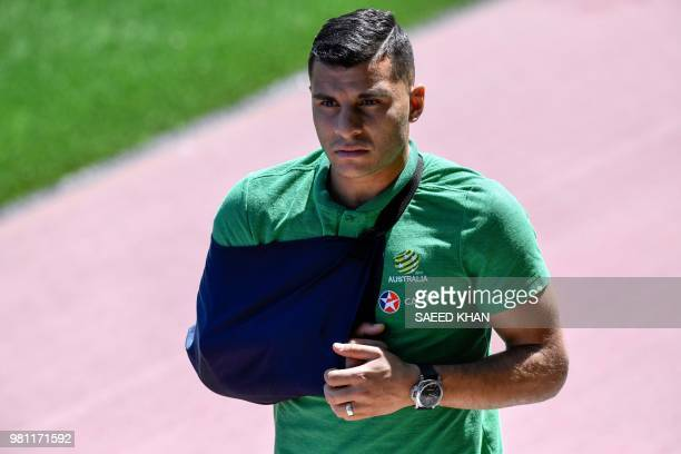 Injured Australia's forward Andrew Nabbout arrives for a training session in Kazan on June 22 during the Russia 2018 World Cup football tournament...