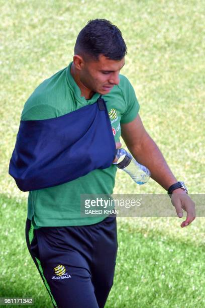 Injured Australia's forward Andrew Nabbout walks back from the football field after a training session in Kazan on June 22 during the Russia 2018...