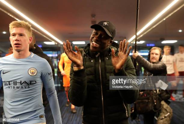 Injured Benjamin Mendy of Manchester City celebrates in the tunnel after The Emirates FA Cup Third Round match between Manchester City and Burnley at...
