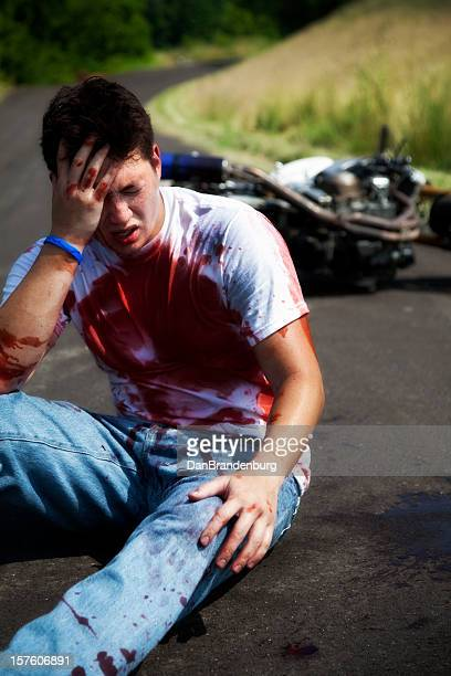 injured biker - motorcycle accident stock pictures, royalty-free photos & images