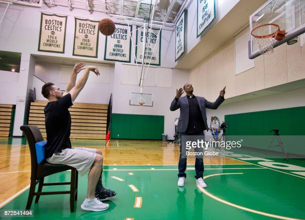 Injured Boston Celtics Gordon Hayward shoots baskets from a chair as Celtic legend Paul Pierce serves as ball boy in Waltham Mass Nov 7 2017 Pierce...