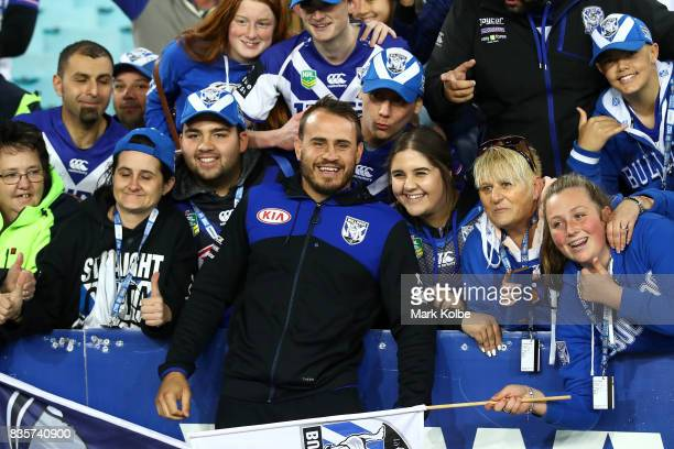 Injured Bulldogs player Josh Reynolds poses with the crowd after Bulldogs final home game of the season in the round 24 NRL match between the...