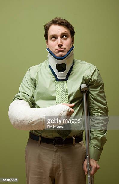 injured businessman - cast colors for broken bones stock pictures, royalty-free photos & images