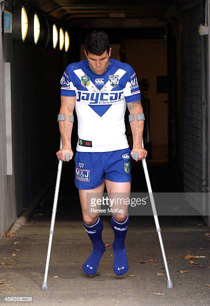 Injured Captain Michael Ennis makes his way out for a Canterbury Bulldogs NRL media session at Belmore Sports Ground on September 30 2014 in Sydney...