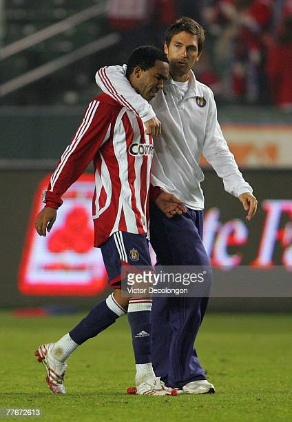 Injured CD Chivas USA player Ante Razov consoles teammate Maykel Galindo after their Western Conference playoff 00 game against the Kansas City...