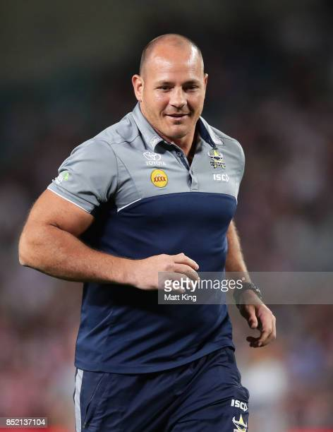 Injured Cowboys player Matt Scott assists Cowboys warm up during the NRL Preliminary Final match between the Sydney Roosters and the North Queensland...