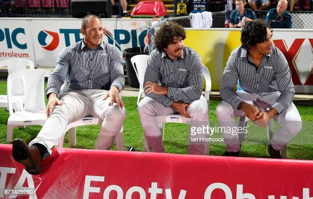 Injured Cowboys players Matthew Scott Jake Granville and Johnathan Thurston are seen sitting on the bench during the round eight NRL match between...