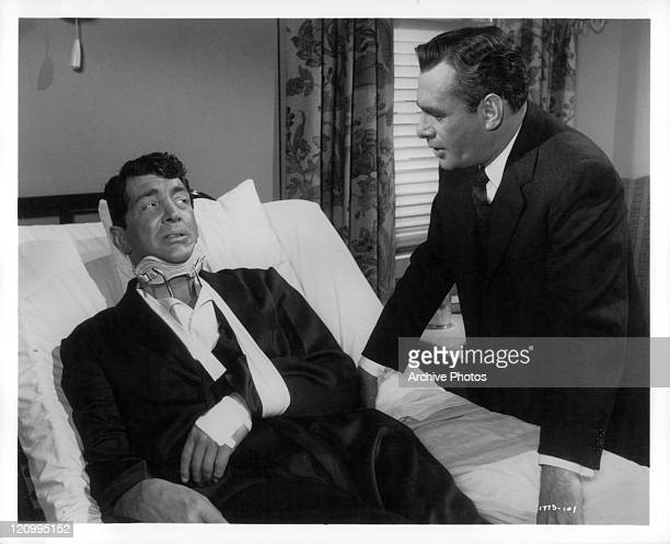 Injured Dean Martin is greeted bedside by Martin Balsam in a scene from the film 'Ada' 1961
