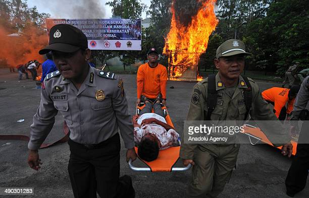 Injured demonstrators demanding the president reelection receive help from medical personnel following the clashes with Indonesian police during the...