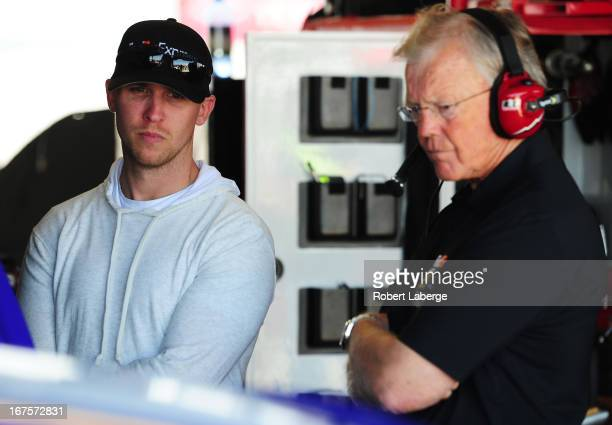 Injured driver Denny Hamlin chats with car owner Joe Gibbs in the garage during practice for the NASCAR Sprint Cup Series Toyota Owners 400 at...