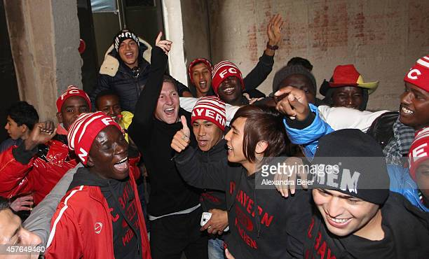 Injured FC Bayern Muenchen midfielder Bastian Schweinsteiger celebrates with refugees during a charity event in the refugee camp and former German...
