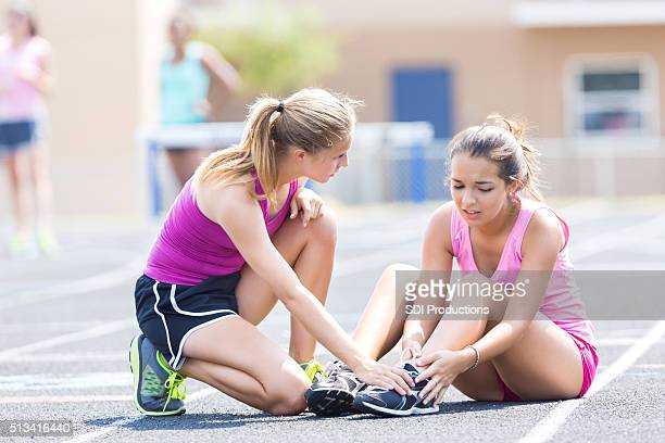 injured female runner at track meet - head injury stock photos and pictures
