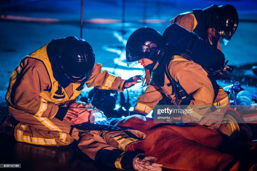 Injured firefighter : Stock Photo