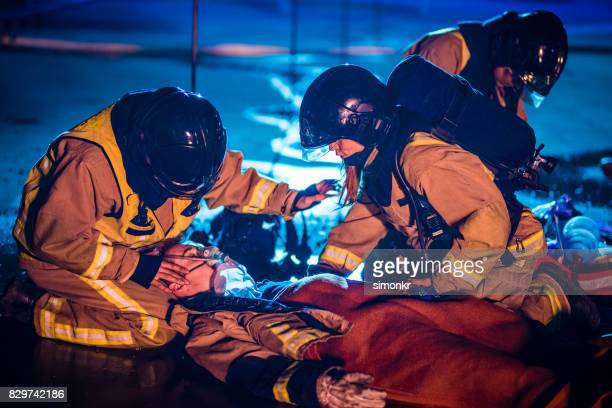 injured firefighter - emergency first response stock photos and pictures
